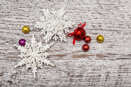 decorative objects: Top view of christmas decorative objects like white snowflake figurine and red bell with ribbon