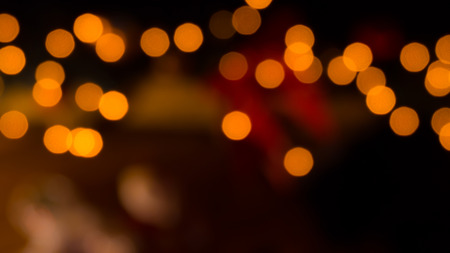 glimmer: Defocued gold colored lights background in the christmas night