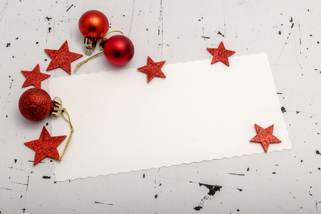 motivos navide�os: Top view of white blank paper sheet with red stars and baubles