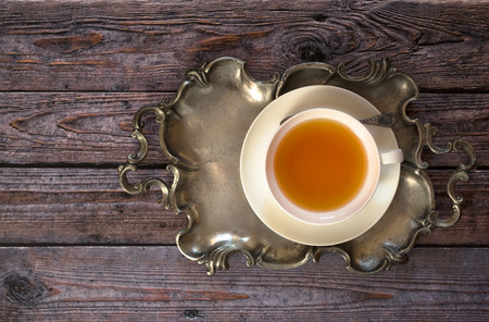 metalic: Top view of hot tea served in metalic tray on wooden table Stock Photo