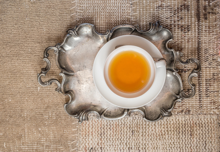 metalic: Top view of hot tea served in metalic tray on vintage background Stock Photo