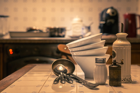 Closeup of bowls and spoons on kitchen table Stock Photo