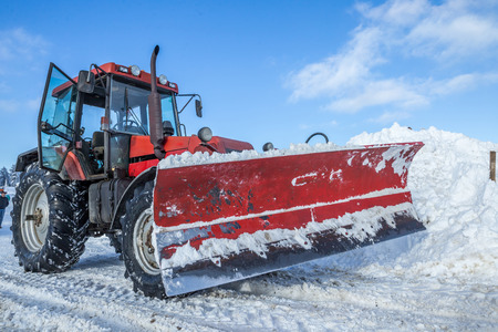 snow plow: Closeup of big snow plow machine ready for road cleaning Stock Photo