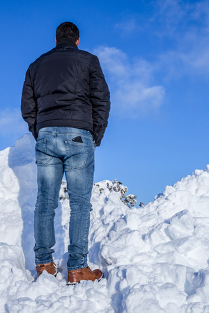 looking ahead: Back view of standing man looking ahead in the winter Stock Photo