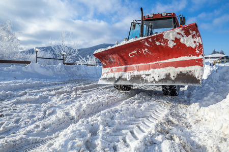 snow plow: Snow Plow machine outside on the snowy winter road