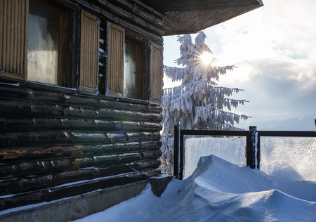 chalet: Closeup of wooden chalet wall in the snowy mountain