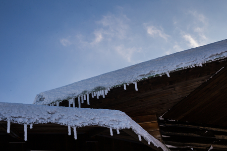 chalet: Closeup of wooden chalet roofs covered with heavy snow