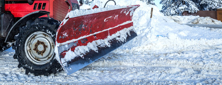 Closeup of snowplough machinery cleaning the snowy road Banco de Imagens