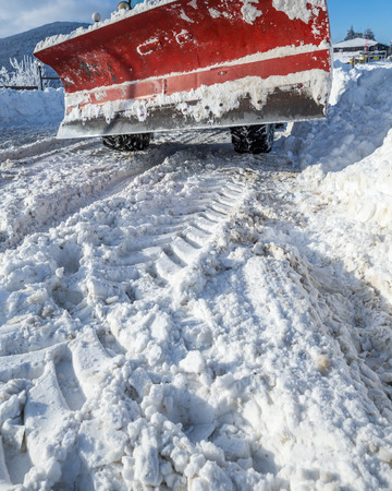 Snow plow truck on snowy mountain road Banco de Imagens
