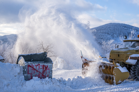 blower: Snow blower machine cleaning mountain snowy road