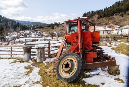 nostalgic: Nostalgic scene of countryside agricultural fields and aged machine Stock Photo