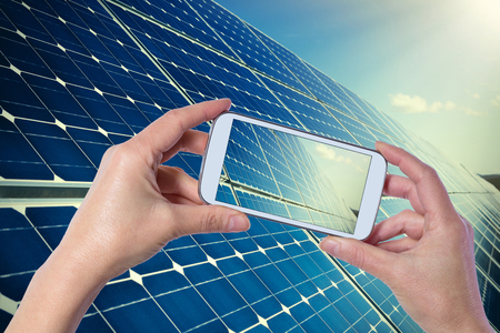 solar collector: Taking picture with mobile phone of blue solar panels