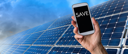 energy picture: Human hand holding smart phone showing save text