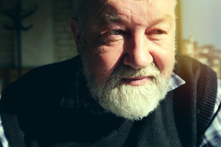looking ahead: Portrait of mature man with beard looking ahead, closeup shot Stock Photo