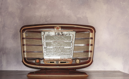 vintage background: Closeup of old vintage russian radio against paint background