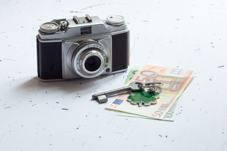 occupancy: Closeup of euro paper money and old photo camera Stock Photo