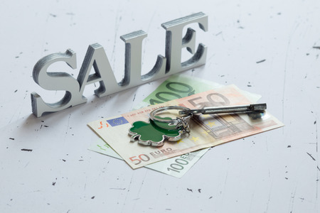 occupancy: Closeup of word sale next to euro banknotes