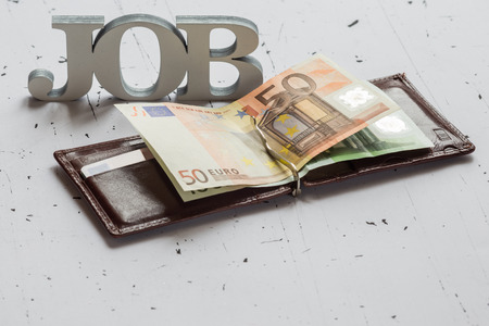 occupancy: Closeup of leather wallet with euro banknotes Stock Photo