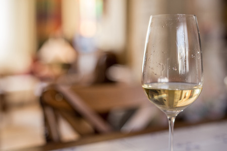tender tenderness: Glass of wine against defocused background at home Stock Photo