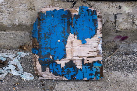 grimy: Closeup of damaged wooden board with cracky paint