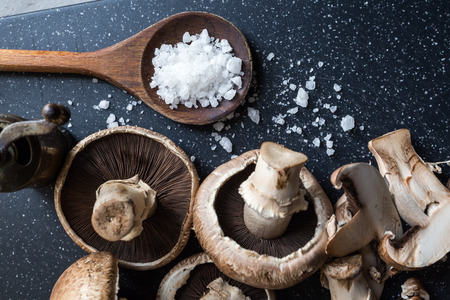 Top view of fresh mushrooms and sea salt crystals