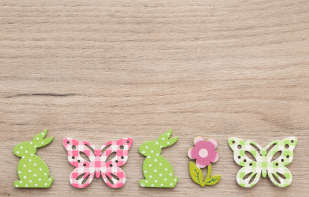 Closeup of easter figurines over wooden background