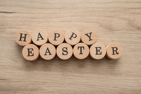Wooden Easter text over wooden background
