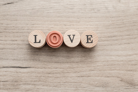 Closeup of love sign on wooden background, top view Banco de Imagens