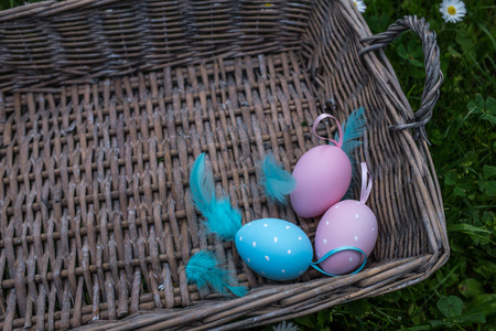 feathering: Painted Easter eggs with feathering in basket Stock Photo
