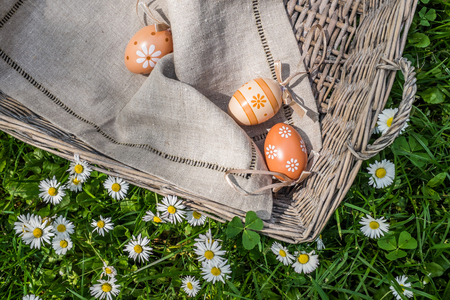 oudoors: Closeup of painted Easter eggs in basket in nature Stock Photo