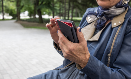 oldish: Closeup of elderly female hands holding mobile phone