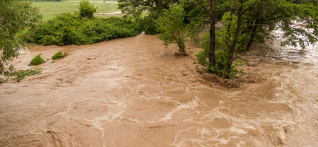 turbulent: Wild turbulent river flooding Stock Photo