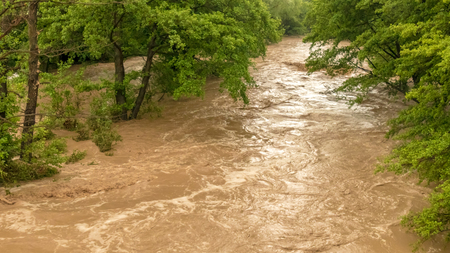 deluge: Turbulent river flooding the rainy forest Stock Photo
