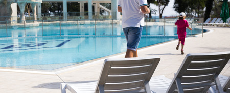 sunbeds: Outside summer swimming pool and sunbeds