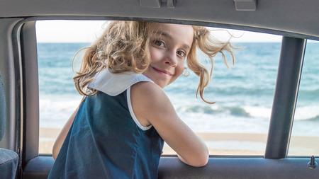 vehicle window: Closeup portrait of happy smiling girl from vehicle window Stock Photo