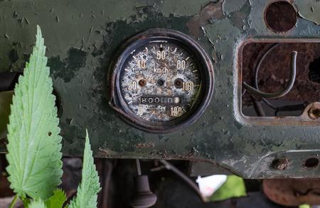 oldish: Closeup of old metallic speedometer of retro vehicle
