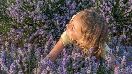 lavanda: Little blonde girl happy for fresh lavender flowers