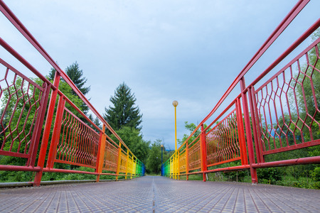 guardrails: Park walking path with street art establishment