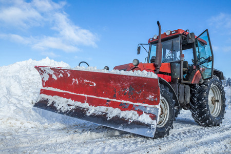 snow plow: Big snow plow in opeeration on snowy mountain road Stock Photo