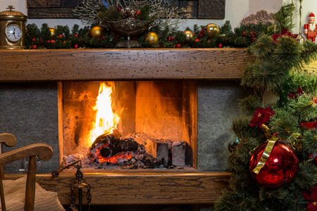 fireplace home: Cozy home ambience of burning fireplace and christmas decorations Stock Photo