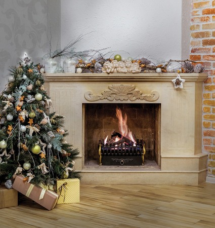 fireplace home: Warm home interior of burning fireplace and decorated Christmas tree