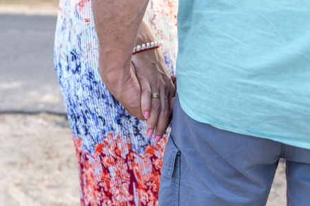 tenderly: Closeup of lovely couple tenderly holding hands Stock Photo