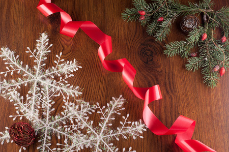 hristmas: hristmas decoration with red ribbon on a wooden board
