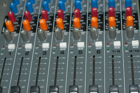 the mixing: audio mixing consoles for sound and mixing in closeup