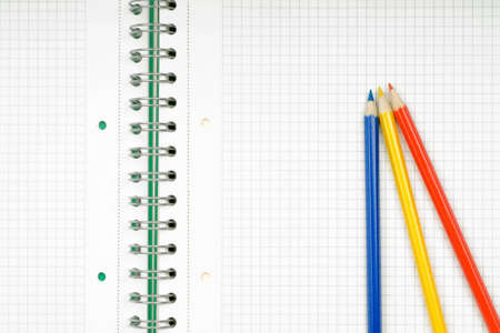close up of notebook and pencil on white background Stock Photo - 5233396