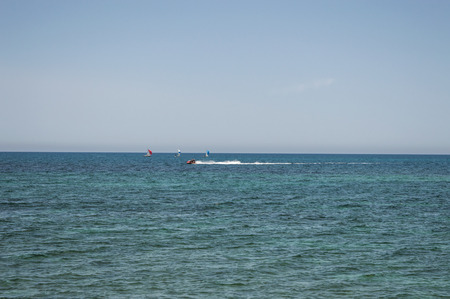water panoramic: sea and boat.Sailing boat yacht and sailboat group regatta race on sea water. Panoramic view.