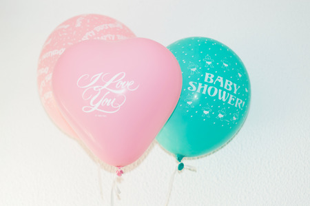 green day baby blue background: Set of colorful birthday or party balloons. Stock Photo