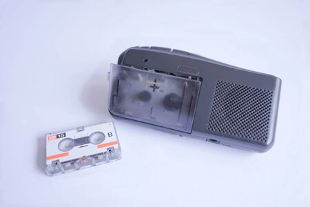 Old cassette tape player on white