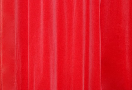Closed beautiful red theater silk curtain background with wave background Reklamní fotografie
