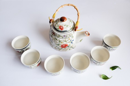 teacups: beautiful teapot and teacups on white background Stock Photo